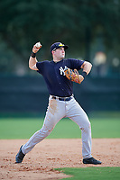 GCL Yankees West third baseman Mitchell Robinson (34) throws to first base during the first game of a doubleheader against the GCL Braves on July 30, 2018 at Champion Stadium in Kissimmee, Florida.  GCL Yankees West defeated GCL Braves 7-5.  (Mike Janes/Four Seam Images)