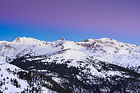 The early morning Sun turns the sky above the Continental Divide Colorado a stunning blue and purple.