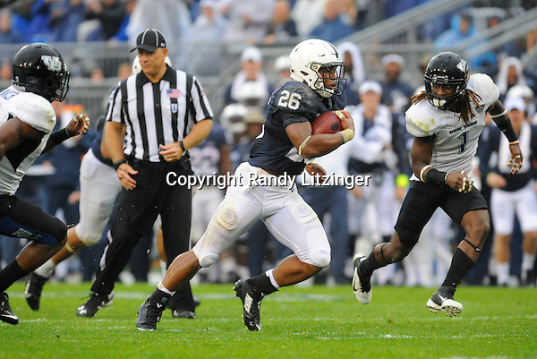 12 September 2015:  Penn State true freshman RB Saquon Barkley (26) runs for a long gain, after hurdling two defenders. Barkley ran for 115 yards and a touchdown. The Penn State Nittany Lions defeated the Buffalo Bulls 27-14 at Beaver Stadium in State College, PA.