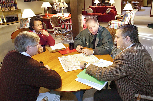 Thurmont, MD - September 29, 2001 -- United States President George W. Bush receives a briefing during a meeting with Central Intelligence Agency (CIA) Director George Tenent, right, National Security Advisor Condoleezza Rice, and White House Chief of Staff Andy Card at Camp David,the Presidential retreat near Thurmont, Maryland, on  Saturday, September 29, 2001..Credit: Eric Draper - White House via CNP
