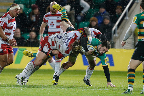 27.11.2015.  Franklin's Gardens, Northampton, England. Aviva Premiership. Northampton Saints versus Gloucester. George North of Northampton Saints is tackled by Richard Hibbard of Gloucester Rugby.