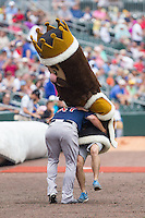 "Charlotte Knights Royalty Racer ""King Mecklenberg"" is tackled by Pawtucket Red Sox catcher Matt Spring (47) at BB&T Ballpark on August 8, 2014 in Charlotte, North Carolina.  The Red Sox defeated the Knights  11-8.  (Brian Westerholt/Four Seam Images)"