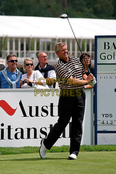 COLIN MONTGOMERIE.At the Colin Montgomerie Charity Golf Tournament, .Golfclub Fontana, Baden bei Wien, Austria,.4th June 2007..full length game sport club course playing golfer.CAP/PPG.©Eckharter/People Picture/Capital Pictures. *** Local Caption *** 00310444