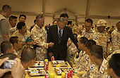 United States Secretary of Defense Donald H. Rumsfeld (center) meets with Korean soldiers in Irbil, Iraq, on October 10, 2004.  Rumsfeld is in Iraq to show support for the coalition troops and meet with Iraqi officials.  <br /> Mandatory Credit: James M. Bowman / DoD via CNP