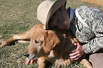 A country boy showing affection to a family dog