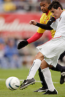 The MetroStars' Sergio Galvan Rey is marked by  Kelly Gray of the Fire. The MetroStars defeated the Chicago Fire 2-0 during the inaugural Hall of Fame game on Monday October 11, 2004 at At-A-Glance Field at the National Soccer Hall of Fame and Museum, Oneonta, NY..
