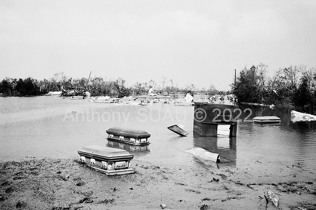 Cameron, Louisianna<br /> September 27, 2005 <br /> <br /> Coffin's float in the water after Hurricane Rita damaged the town's cemetery.