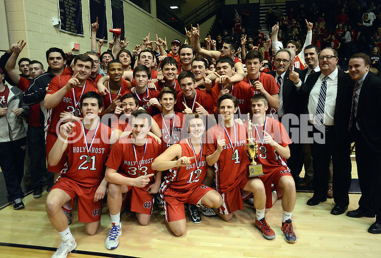 Holy Ghost players pose for a team photo with their trophy after defeating Lower Moreland 74-54 to win the District One Class AAA boys basketball championship game Saturday February 27, 2016 at Council Rock South in Northampton, Pennsylvania. (Photo by William Thomas Cain)