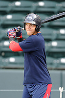 Catcher Carlos Coste (7) of the Greenville Drive waits to take batting practice before a game against the Kannapolis Intimidators on Friday, April 11, 2014, at Fluor Field at the West End in Greenville, South Carolina. Greenville won, 13-2. (Tom Priddy/Four Seam Images)