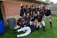 Batavia Muckdogs Julio Frias, Ronal Reynoso, Edgar Martinez, Dalvy Rosario, Andres Sthormes, Joey Steele, Jonaiker Villalobos (standing);  Milton Smith II, Michael Hernandez, Edison Suriel, Geremy Galindez (kneeling); and Julian Infante (on ground) celebrate after clinching the Pinckney Division Title during a NY-Penn League game against the Auburn Doubledays on September 2, 2019 at Falcon Park in Auburn, New York.  Batavia defeated Auburn 7-0 to clinch the Pinckney Division Title.  (Mike Janes/Four Seam Images)