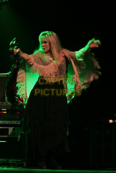 STEVIE NICKS .Honorary Heart Breaker Stevie Nicks performs live with  Tom Petty & The Heart Breakers at The Coors Ampitheatre in Chula Vista  ,California, USA..September 27th, 2006 .Ref: DVS.full length stage concert live gig performance music beige shawl dancing.www.capitalpictures.com.sales@capitalpictures.com.©Debbie VanStory/Capital Pictures
