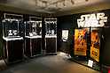 Various commemorative 24k gold coin sets and products of the film Star Wars on display at the Ginza Tanaka jewelry store in Ginza on November 19, 2015, Tokyo, Japan. In May 2015 Ginza Tanaka began launching Star Wars commemorative 24k gold coin sets, in prices ranging from 500 to 8000 USD. All the sets sold out and now the jewelry store is preparing a new piece to commemorate the film Star Wars The Force Awakens. (Photo by Rodrigo Reyes Marin/AFLO)