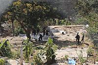 Messico,Guerrero, Acapulco,Puerto Marquez.28 Novembre 2010.350 Famiglie sgomberate a cui sono state distrutte e bruciate le case per far posto a edilizia turistica.Tappa della carovana di Via Campesina partita da Acapulco per partecipare al forum alternativo per la Vita e la giustizia ambientale e sociale.Mexico, Cuernavaca.Convoy of Via Campesina to COP 16, Cancun