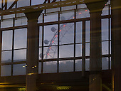 The London Eye on the Southbank of the River Thames in London seen from Waterloo station at dusk.   The present Waterloo opened in 1910 replacing a confusion of three separate stations all on much the same site.  The London Eye stands 135 metres tall and carries 3.5 million visitors each year.  Conceived and designed by David Marks & Julia Barfield, it took 7 years to design & build and involved products made by specialists in 5 countries.   It was originally sponsored by British Airways, who ran it from 2000 until 2005, when it was known as the Millenium Wheel.