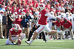 Wisconsin Badgers holder Connor Allen (90) holds the ball for kicker Rafael Gaglianone (27) during an NCAA College Football game against the Florida Atlantic Owls Saturday, September 9, 2017, in Madison, Wis. The Badgers won 31-14. (Photo by David Stluka)