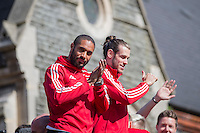 Ashley Williams and Gareth Bale wave to fans during the Homecoming open top bus tour of the Wales Euro 2016 Squad in Cardiff City Centre, Cardiff. 8 July 2016. Photo by Mark  Hawkins / PRiME Media Images.
