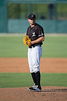 Kannapolis Intimidators relief pitcher Mike Morrison (24) looks to his catcher for the sign against the Hagerstown Suns at Kannapolis Intimidators Stadium on June 15, 2017 in Kannapolis, North Carolina.  The Intimidators walked-off the Suns 5-4 in game one of a double-header.  (Brian Westerholt/Four Seam Images)