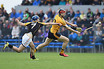 Darach Honan of Clonlara in action against James Murphy of Ballyea during their senior county final replay at Cusack Park. Photograph by John Kelly.