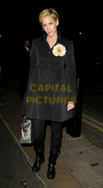 """LISA BUTCHER  .The """"Skellig"""" VIP screening, Curzon Mayfair cinema, London, England..March 25th, 2009.full length jacket coat black boots flowers corsage beige .CAP/CAN.©Can Nguyen/Capital Pictures."""