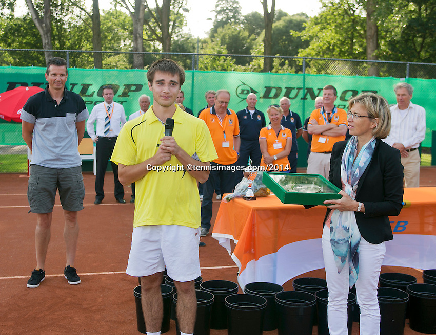 August 9, 2014, Netherlands, Rotterdam, TV Victoria, Tennis, National Junior Championships, NJK,  Prize giving, Richard Krajicek with Guy den Heijer, winner boys 18 years giving his winners speech, right Petra Hermans-Verloop, tournament director.<br /> <br /> Photo: Tennisimages/Henk Koster