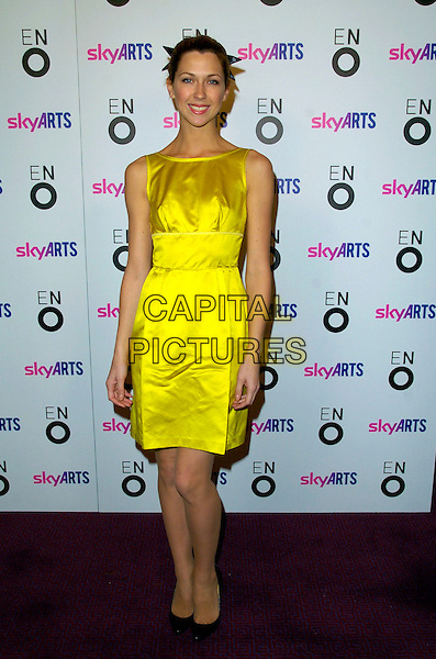 """MARGO STILLEY.The """"Aida"""" press night, London Coliseum Theatre, London, England..November 8th, 2007.full length margot stilly yellow satin sleeveless dress .CAP/CAN.©Can Nguyen/Capital Pictures"""