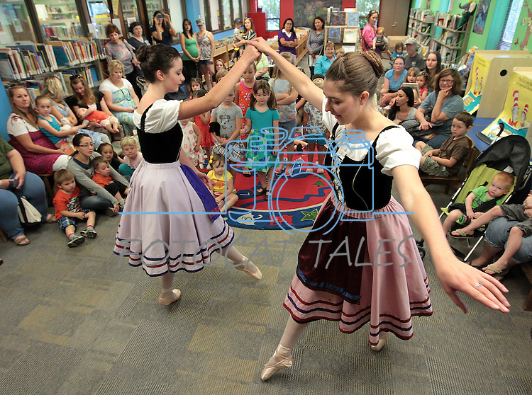 """Sierra Nevada Ballet dancers Kaitlin Vairo, 14, left, and Kiara Riske, 17, dance during storytime at the Carson City Library on Wednesday, July 25, 2012. Members of the """"Giselle"""" cast were promoting Thursday's free performance of excerpts at Dancing by the River at Wingfield Park at 8 p.m. in addition to their full show at Sand Harbor on July 30. More information available from www.sierranevadaballet.com..Photo by Cathleen Allison/Nevada Photo Source"""