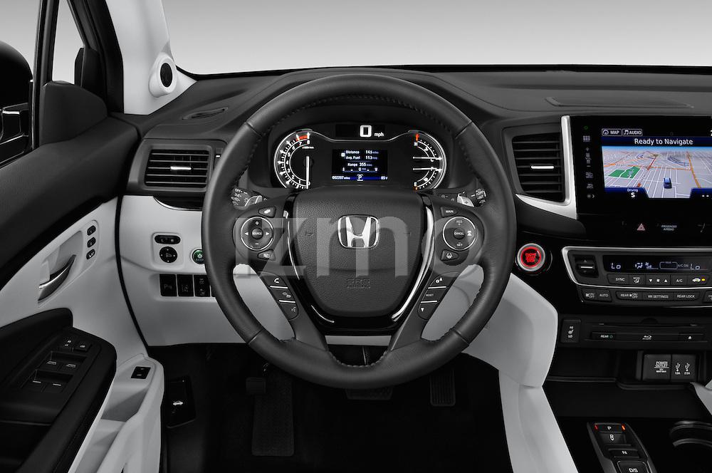 Car pictures of steering wheel view of a 2018 Honda Pilot Touring 5 Door Suv Steering Wheel