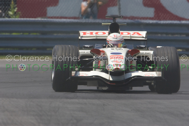 MONTREAL - JUNE 24: Jensen Button of Honday Racing enters the Senna complex of turns 1 and 2 during Saturday qualifying for the Canadian F1 Grand Prix at the Circuit Gilles-Villeneuve June 24, 2006 in Montreal, Canada.