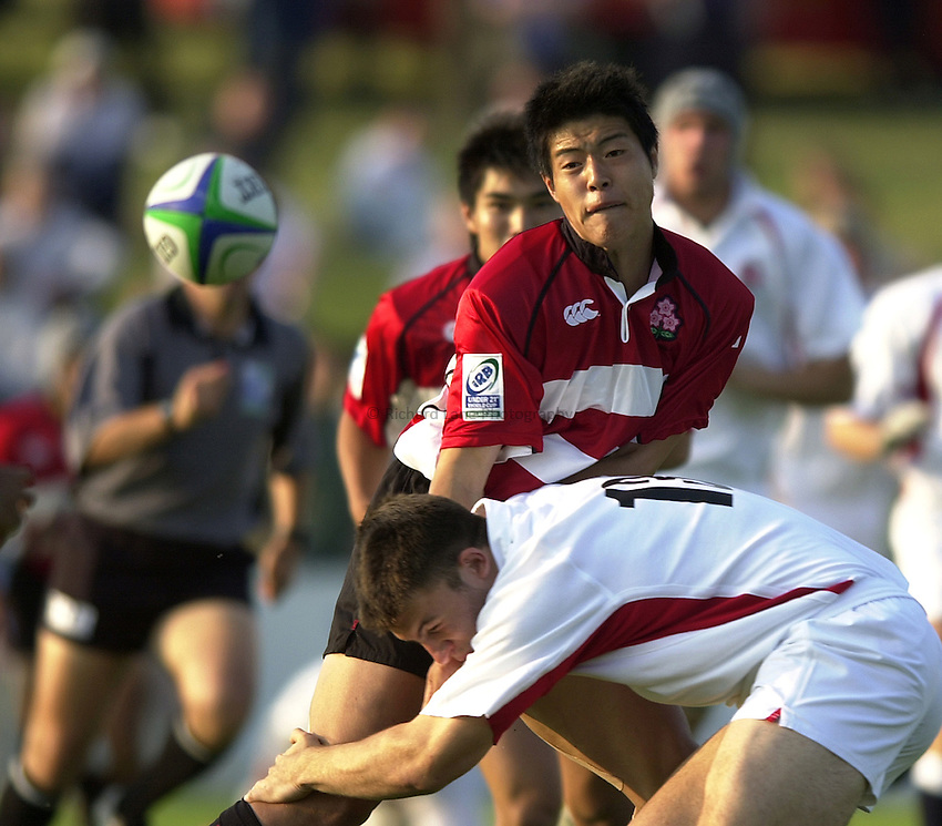 Photo: Richard Lane..Japan U21 v England U21. IRB Under U21 Rugby World Cup 2003 at Newbury RFC. 17/06/2003..Hiroshi Toyoyama gets the ball away.