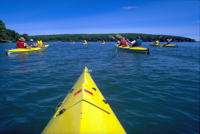 Sea kayaking in the Apostle Islands National Lakeshore in Lake Superior with Wilderness Inquiry near Bayfield, Wisconsin.