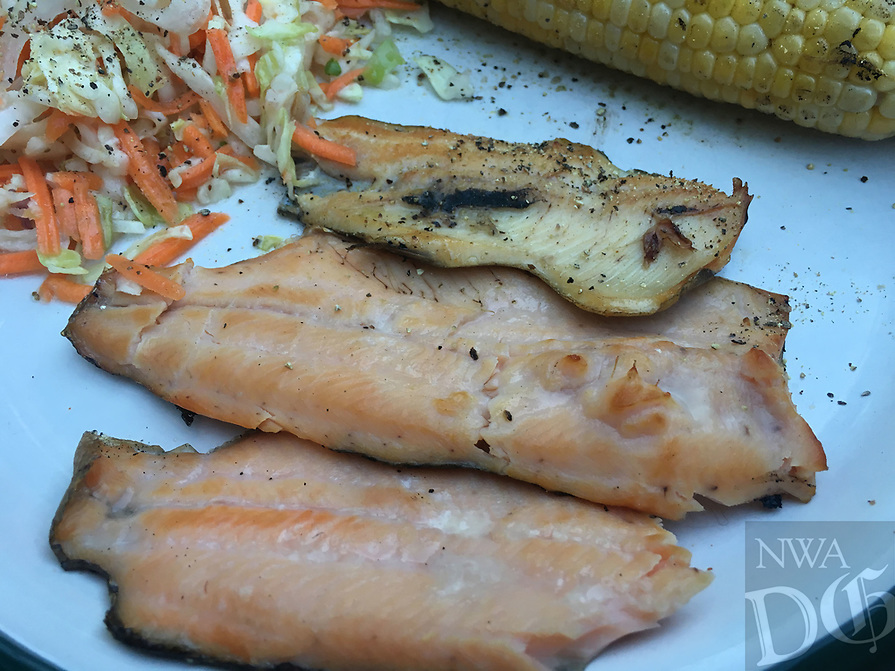 NWA Democrat-Gazette/FLIP PUTTHOFF <br /> Delcious smoked trout can be ready       July 23 2019    in as little as 90 minutes using a charcoal grill with a lid.