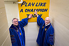 "May 21, 2017; University of Notre Dame President Rev. John I. Jenkins, C.S.C. and Vice President Mike Pence touch the ""Play Like A Champion Today"" sign in the football locker room before Commencement 2017. Vice President Pence received an honorary degree and was the Commencement speaker at the ceremony. (Photo by Matt Cashore/University of Notre Dame)"