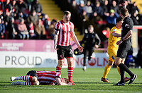 Referee Michael Salisbury calls for Lincoln City's head of sports science and medicine Mike Hine to come onto the pitch to treat Lincoln City's Lee Frecklington for an injury<br /> <br /> Photographer Chris Vaughan/CameraSport<br /> <br /> The EFL Sky Bet League Two - Lincoln City v Northampton Town - Saturday 9th February 2019 - Sincil Bank - Lincoln<br /> <br /> World Copyright &copy; 2019 CameraSport. All rights reserved. 43 Linden Ave. Countesthorpe. Leicester. England. LE8 5PG - Tel: +44 (0) 116 277 4147 - admin@camerasport.com - www.camerasport.com