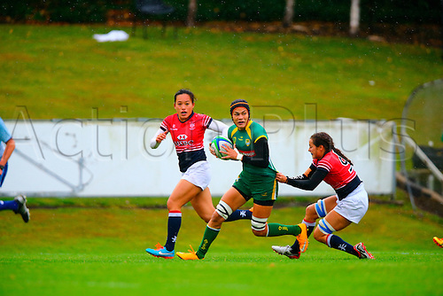 23.08.2015. Dublin, Ireland. Women's Sevens Series Qualifier 2015. Brazil versus Hong Kong<br /> Beatriz Muhlbauer (Brazil) is held back by Lindsay Varty (Hong Kong).