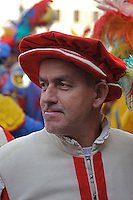 A Florentine reenactor dressed in renaissance attire during a city celebration.