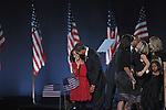 U.S. President Elect kisses his eldest daughter Malia Obama on stage as they are joined by other members of Obama's family and Vice-President Elect Joseph Biden's family after Obama delivered his victory speech on election night 2008 in Grant Park in Chicago, Illinois on November 4, 2008.