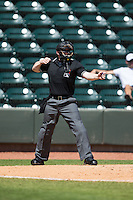 Home plate umpire Chase Eade calls a batter out on strikes during the Carolina League game between the Carolina Mudcats and the Winston-Salem Dash at BB&T Ballpark on April 22, 2015 in Winston-Salem, North Carolina.  The Dash defeated the Mudcats 4-2..  (Brian Westerholt/Four Seam Images)