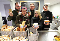 Pictured: Volunteers handing out food and drinks Tuesday 29 November 2016<br />Re: Soup kitchen for homeless people organised by Swansea City FC and Woolwich at the Liberty Stadium, Wales, UK