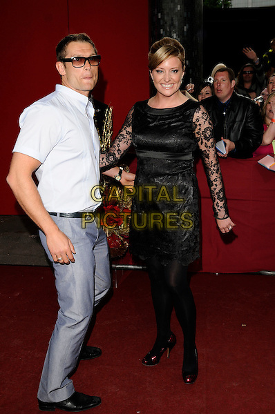 JOHN PARTRIDGE, LAURIE BRETT.Arrivals - the British Soap Awards 2009,.BBC Television Centre, Wood Lane, London, England, UK, May 9th 2009..soaps tv full length Eastenders black dress lace sleeves tights sunglasses white shirt blue grey gray trousers red shoes .CAP/CAN.©Can Nguyen/Capital Pictures