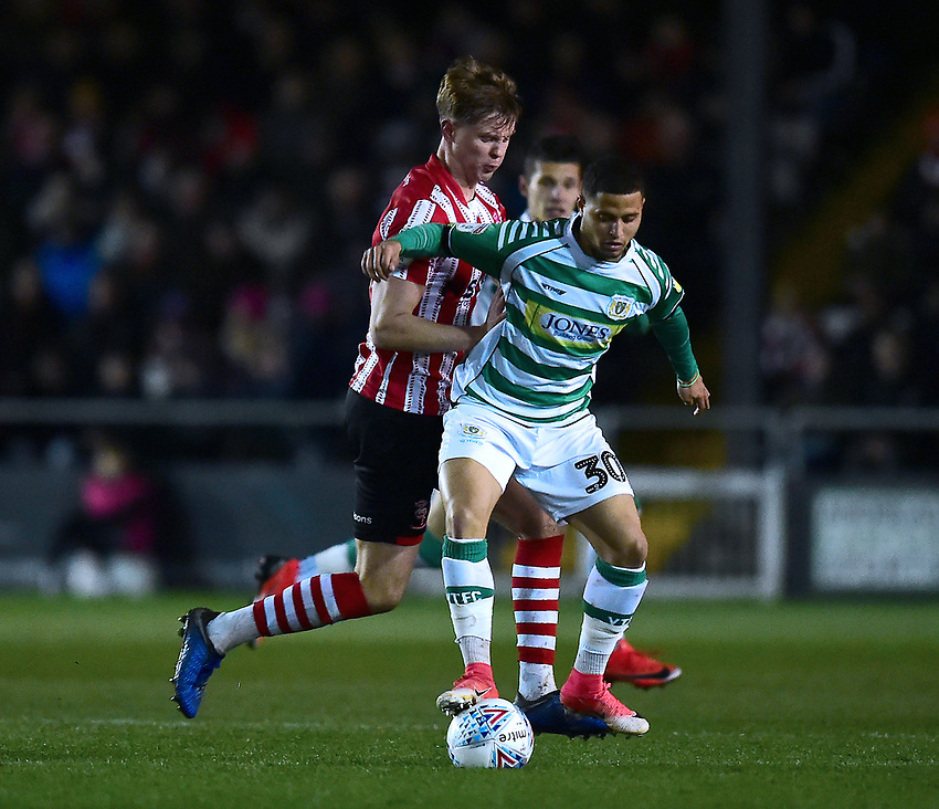 Yeovil Town's Alefe Santos shields the ball from Lincoln City's Mark O'Hara<br /> <br /> Photographer Andrew Vaughan/CameraSport<br /> <br /> The EFL Sky Bet League Two - Lincoln City v Yeovil Town - Friday 8th March 2019 - Sincil Bank - Lincoln<br /> <br /> World Copyright © 2019 CameraSport. All rights reserved. 43 Linden Ave. Countesthorpe. Leicester. England. LE8 5PG - Tel: +44 (0) 116 277 4147 - admin@camerasport.com - www.camerasport.com