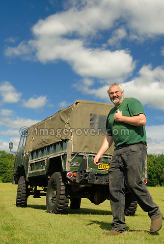 Phil Bashall of the Dunsfold Collection besides a Military Land Rover 101. Dunsfold Collection Open Day 2009. NO RELEASES AVAILABLE.