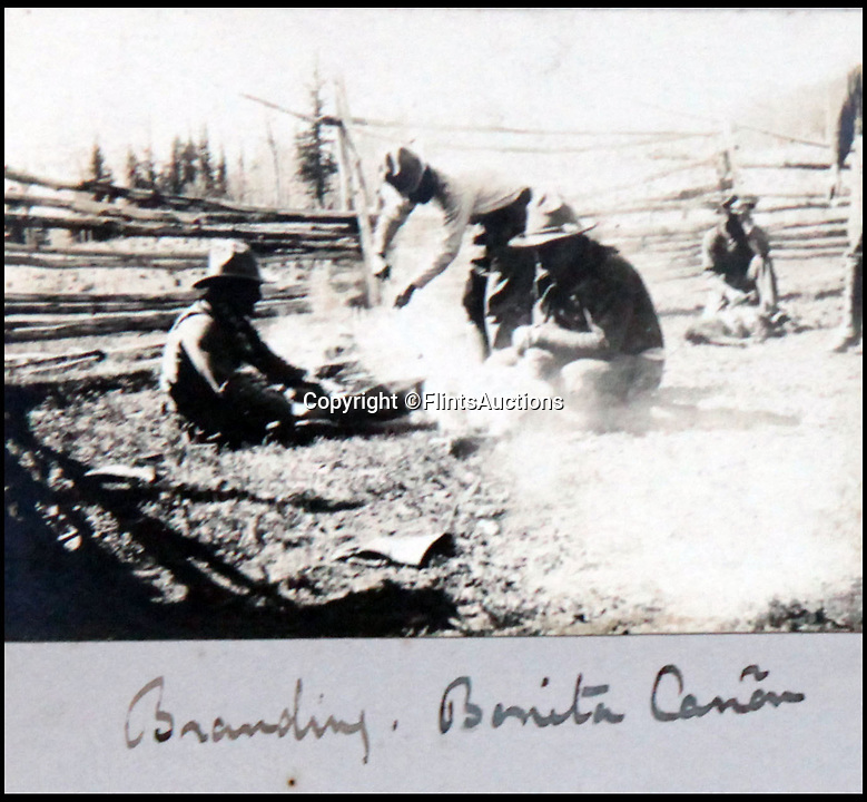 BNPS.co.uk (01202 558833)<br /> Pic: FlintsAuctions/BNPS<br /> <br /> Branding in Bonita Canyon.<br /> <br /> Unseen album reveals the life of a cowboy in the real wild west...<br /> <br /> Fascinating previously unseen early photos of cowboys in the Wild West have come to light 130 years later.<br /> <br /> They show life on the ranches of Colorado and New Mexico in the vast expanses of the south west US in the 1880s.<br /> <br /> One dramatic image captures the thrilling moment a group of cowboys ride towards the camera with hats held aloft.<br /> <br /> The photos are thought to have been taken by a British farmhand who travelled Stateside in the late 19th century to earn a living.