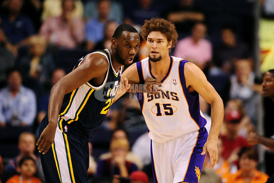 Oct. 12, 2010; Phoenix, AZ, USA; Utah Jazz center (25) Al Jefferson is defended by Phoenix Suns center (15) Robin Lopez during a preseason game at the US Airways Center. Mandatory Credit: Mark J. Rebilas-