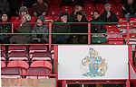 Altrincham 2 Worcester City 0, 23/03/2013. Moss Lane, Blue Square Bet North. Spectators chatting in the main stand before the Blue Square Bet North fixture between Altrincham and Worcester City at Moss Lane, Altrincham. The home team won the match 2-0 watched by 777 spectators on a day when most non-League football in England was cancelled due to adverse weather. Altrincham were historically one of the major English non-League teams but have never been promoted to the Football League. Photo by Colin McPherson.