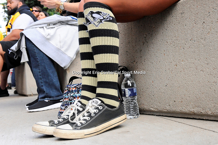 Wednesday, June 1, 2016: A fans wears Penguins socks at game 2 of the NHL Stanley Cup Finals  between the San Jose Sharks and the Pittsburgh Penguins held at the CONSOL Energy Center in Pittsburgh Pennsylvania. The Penguins beat the Sharks in overtime 2-1 and lead the best of 7 series 2-0. Eric Canha/CSM