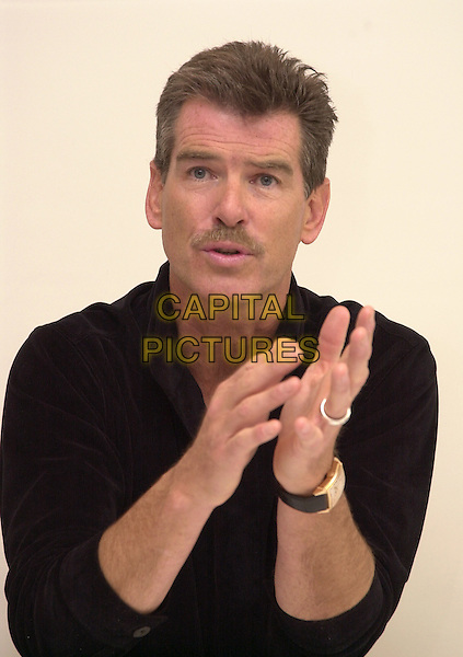 PIERCE BROSNAN.Los Angeles, 2004.headshot, portrait, mustache, facial hair, hands.www.capitalpictures.com.sales@capitalpictures.com.© Capital Pictures.