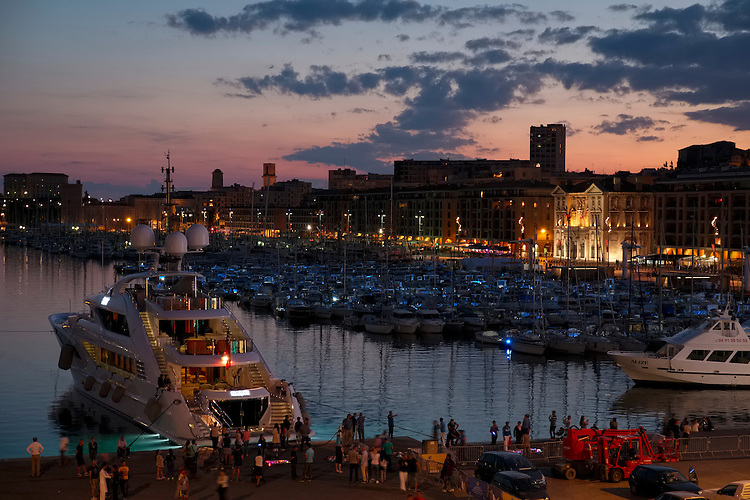 The end of a perfect day on the French coastline is exemplified at dusk in the Old Port harbor of Marseille.