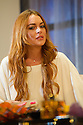 "London, UK. 30.09.2014. ""Speed-the-Plow"", by David Mamet, directed by Lindsay Posner, starring Lindsay Lohan, opens at the Playhouse Theatre. Picture shows: Lindsay Lohan (Karen). Photograph © Jane Hobson."