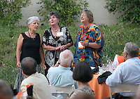 Alumni Reunion Weekend, Saturday, June 21, 2014. From left, Danielle McGrail '74, Elisa Schwartz '74 and Cheryl (Miles) McKinley '74 sing in an impromptu performance at the class of 1974 dinner, Hameetman Science Center. (Photo by Marc Campos, Occidental College Photographer)
