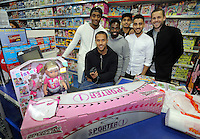 Pictured L-R: Leroy Fer, Wayne Routledge, Nathan Dyer, Kyle Naughton, Neil Taylor and Gylfi Sigurdsson  Wednesday 08 December 2016<br />Re: Swansea City FC players have bought Christmas gifts for 60 children at Smyths toy store in Swansea, south Wales.